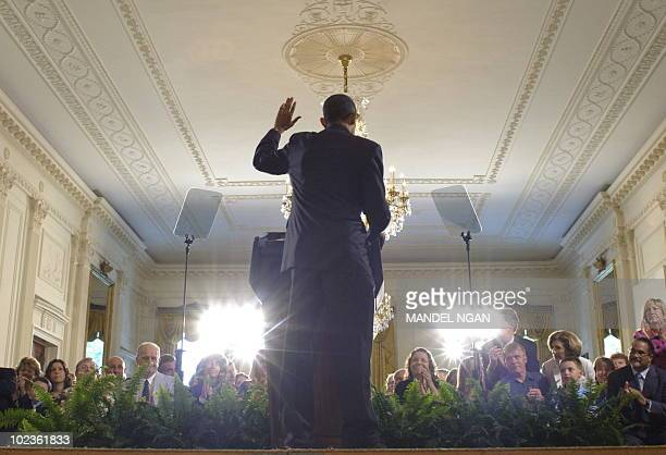 US President Barack Obama waves after speaking at an event on the the 90day anniversary of the signing of the Affordable Care Act June 22 2010 in the...