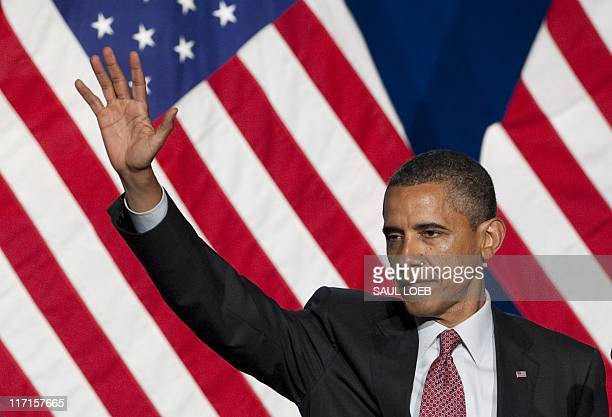 US President Barack Obama waves after speaking at the Democratic National Committee's Lesbian Gay Bisexual Transgender Leadership Gala in New York...