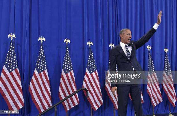 President Barack Obama waves after speaking on counterterrorism at MacDill Air Force Base in Tampa Florida on December 6 2016