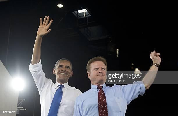 US President Barack Obama waves alongside Virginia Democrat Senator Jim Webb during a campaign event at Farm Bureau Live in Virginia Beach Virginia...