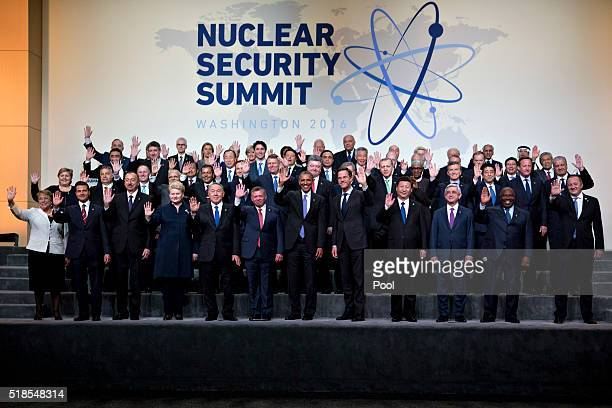 US President Barack Obama waves among other heads of state and attendees during a family photo at the Nuclear Security Summit on April 1 2016 in...