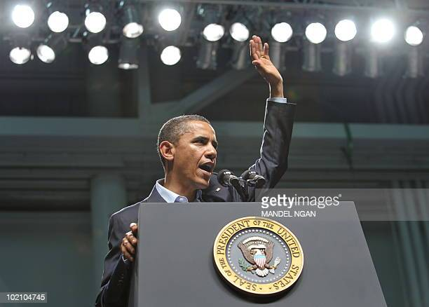 US President Barack Obama waves as as he finishes his address to military personnel at the Naval Air Technical Training Center of the Pensacola Naval...