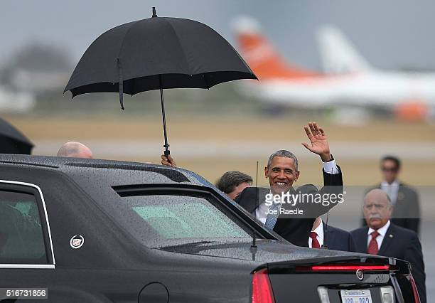 President Barack Obama waves as he arrives at Jose Marti International Airport on Air Force One for a 48hour visit on March 20 2016 in Havana Cuba Mr...