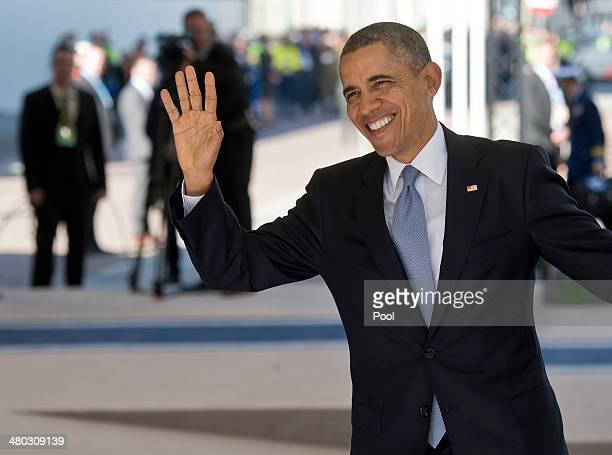 President Barack Obama waves as he arrives at the 2014 Nuclear Security Summit on March 24, 2014 in The Hague, Netherlands. The Nuclear Security...