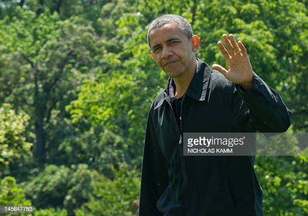 President Barack Obama waves as he arrives at the White House on June 3, 2012 after spending a day at the Camp David presidential retreat. AFP...