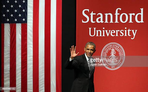 S President Barack Obama waves as he arrives at the White House Summit on Cybersecurity and Consumer Protection on February 13 2015 in Stanford...