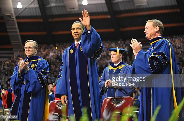 US President Barack Obama waves as he arrives on the stage May 17 2009 to attend the commencement ceremony in the Joyce Center of Notre Dame...