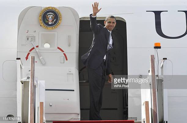 S President Barack Obama waves as he boards Air Force One at Stansted Airport May 26 2011 near London England Obama is leaving Britain for the G8...