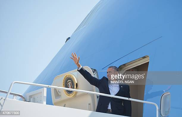 US President Barack Obama waves as he boards Air Force One upon departure from Andrews Air Force Base in Maryland on April 22 2015 Obama is heading...