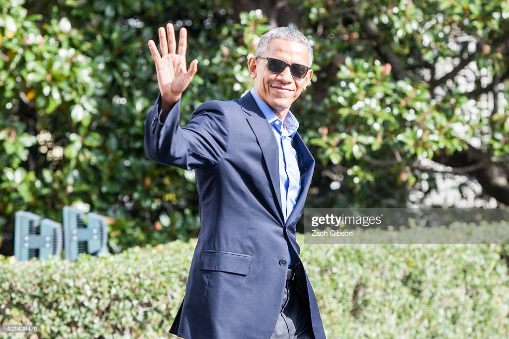 President Barack Obama waves as he exits The White House before boarding Marine One on November 6, 2016 in Washington, DC. President Obama will travel to Orlando to campaign from Democratic Presidential Candidate Hillary Clinton.