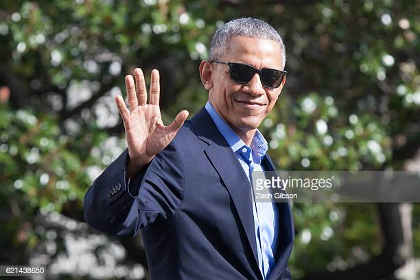 President Barack Obama waves as he exits The White House before boarding Marine One on November 6 2016 in Washington DC President Obama will travel...