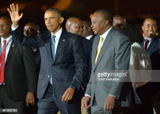 US President Barack Obama waves as he is received by Kenyan President Uhuru Kenyatta July 24 2015 at Nairobi's Jomo Kenyatta Airport after he arrived...