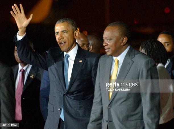 US President Barack Obama waves as he is received by Kenyan President Uhuru Kenyatta on July 24 2015 at tNairobi's Jomo Kenyatta Airport after he...