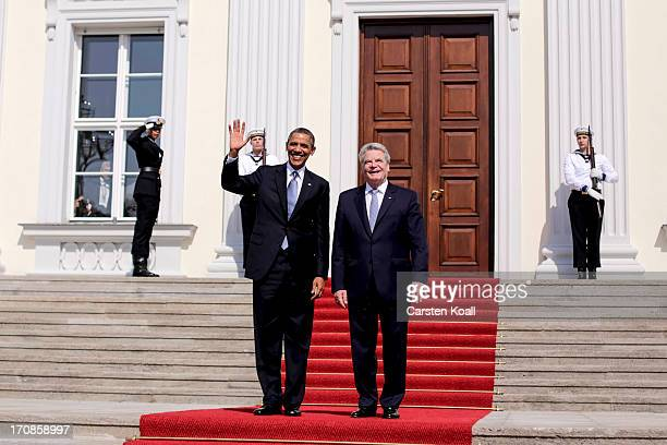 S President Barack Obama waves as he is welcomed by German President Joachim Gauck on June 19 2013 in Berlin Germany Obama is visiting Berlin for the...