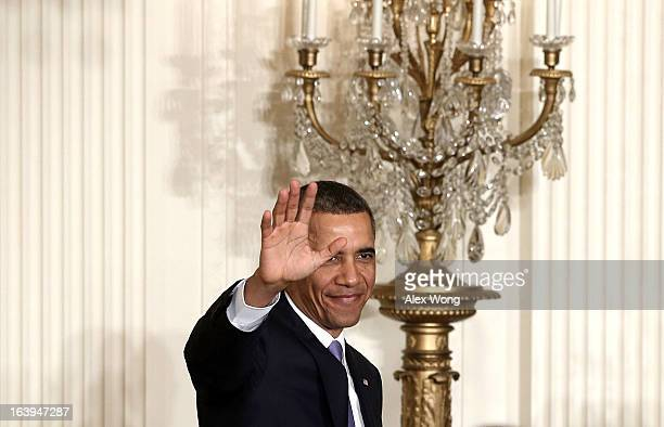 S President Barack Obama waves as he leaves after a personnel announcement March 18 2013 at the East Room of the White House in Washington DC...