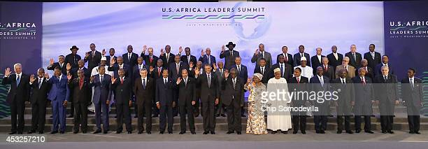 S President Barack Obama waves as he participates in the official 'family photo' with leaders from Africa during the USAfrica Leaders Summit at the...
