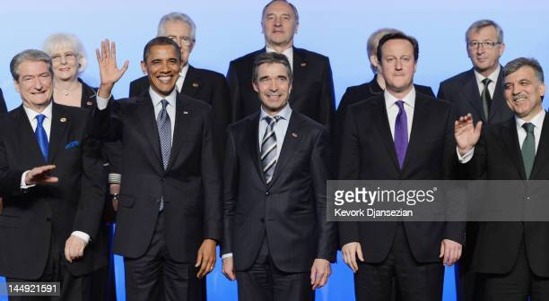 S President Barack Obama waves as he poses for the family photo with Prime Minister of Albania Sali Berisha NATO Secretary General Anders Fogh...