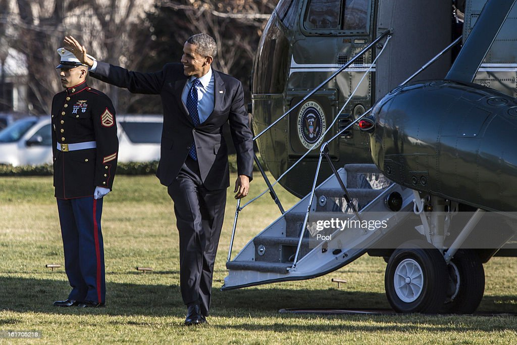 U.S. President Barack Obama waves as he walks off Marine One after arriving at the White House February 14, 2013 in Washington, DC. Obama was returning after a trip to Decatur, Georgia to tout his pre-school initiative.