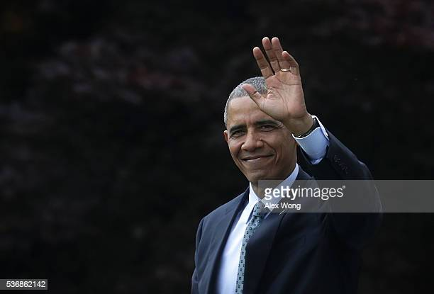 S President Barack Obama waves as he walks towards the Marine One prior to his departure from the White House June 1 2016 in Washington DC President...