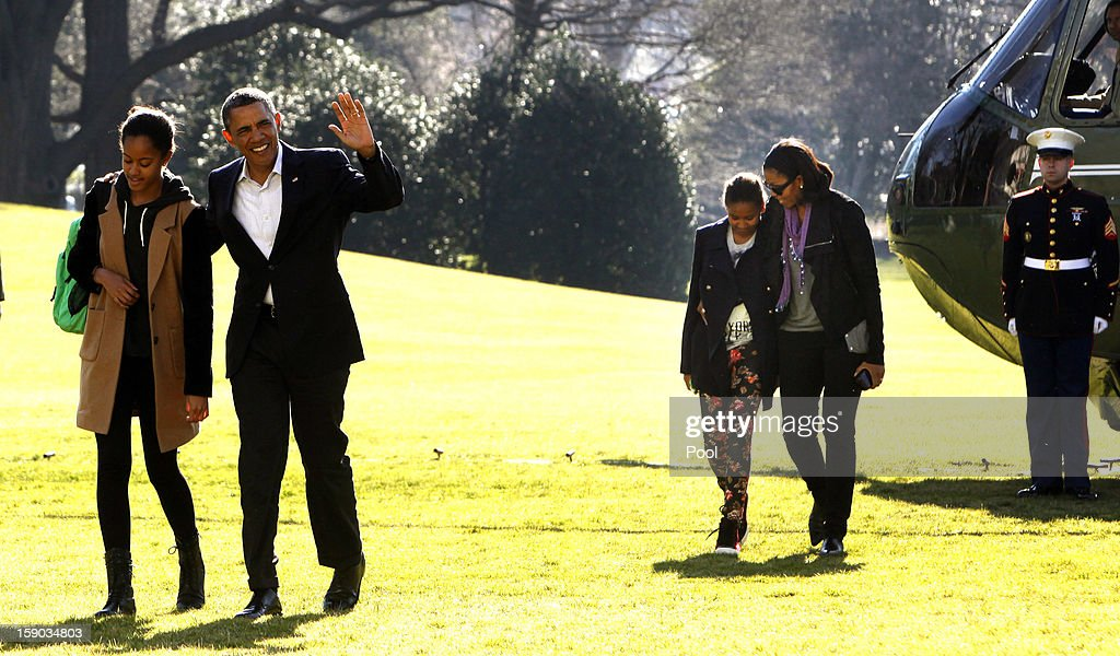 U.S. President Barack Obama waves as he walks with daughter Malia, first lady Michelle Obama walks with daughter Sasha from Marine One to the White House on January 6, 2013 in Washington, DC. Obama is expected to dominate Chuck Hagel, a Republican and former U.S. senator from Nebraska, to succeed Defense Secretary Leon Panetta.
