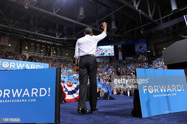 US President Barack Obama waves at supporters during a campaign rally in Boulder Colorado on November 1 2012 Obama and his republican rival Mitt...
