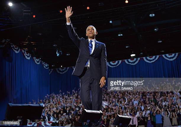 US President Barack Obama waves at supporters following his victory speech on election night November 6 2012 in Chicago Illinois President Barack...