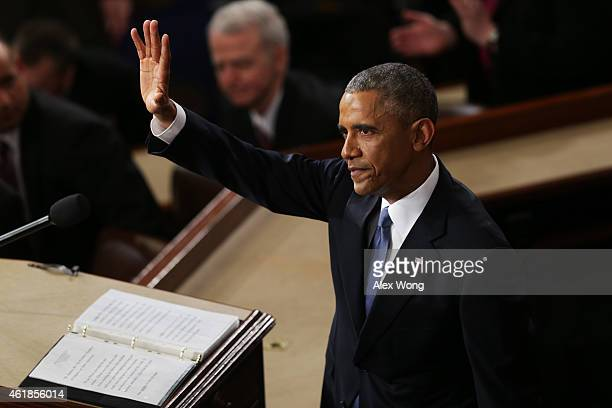 S President Barack Obama waves at the conclusion of his State of the Union speech before members of Congress in the House chamber of the US Capitol...