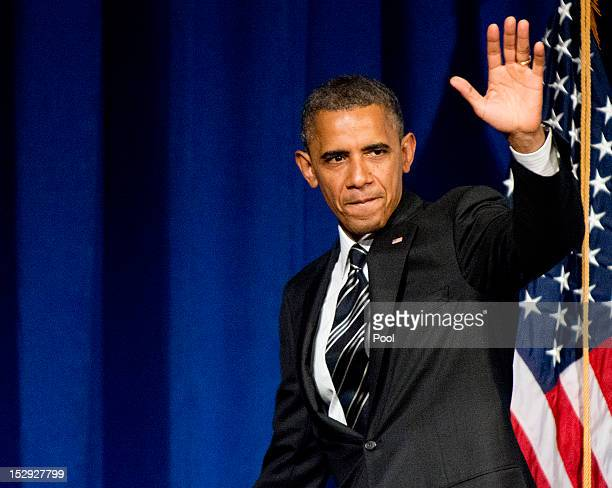 S President Barack Obama waves during a fundraiser event at the Capital Hilton Hotel September 28 2012 in Washington DC Obama will reportedly speak...