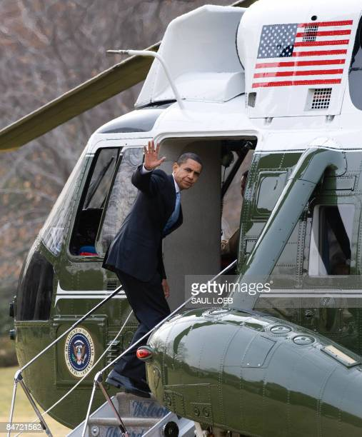President Barack Obama waves from Marine One prior to departure from the South Lawn of the White House in Washington, DC, February 10, 2009. Obama is...