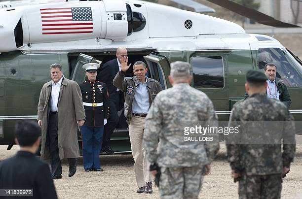 US President Barack Obama waves from Marine One upon arrival at army base Camp Bonifas in Paju during a visit to the Demilitarized Zone on the border...