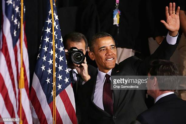 S President Barack Obama waves goodbye as White House Photographer Pete Souza takes photos after Obama delivered remarks about the ConnectED program...