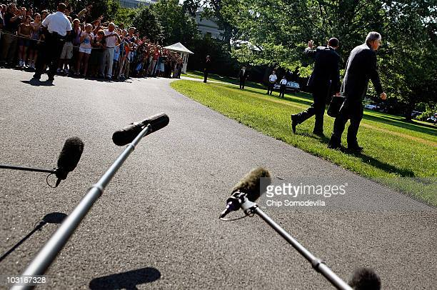 S President Barack Obama waves to guests as he and Transportation Secretary Ray LaHood walk across the South Lawn of the White House before boarding...