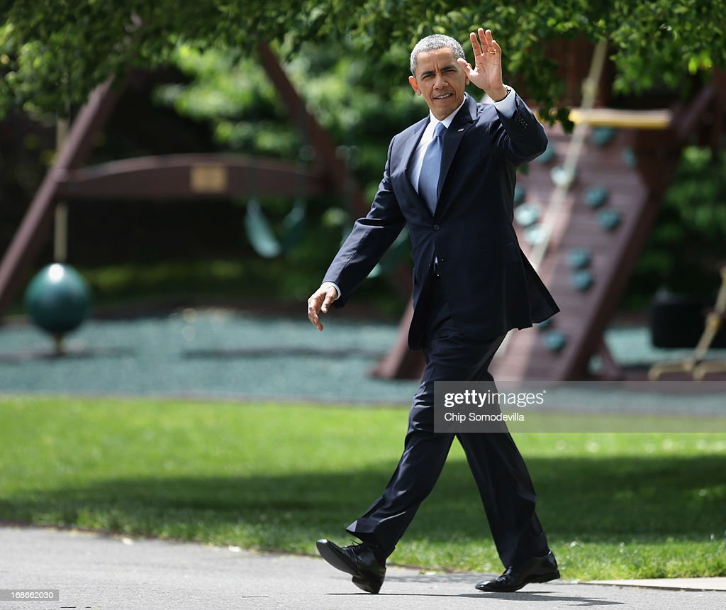 U.S. President Barack Obama waves to members of the news media as he walks across the South Lawn while departing the White House May 13, 2013 in Washington, DC. According to the White House, Obama is traveling to New York City to deliver remarks at two Democratic National Committee events at private residences and a joint Democratic Congressional Campaign Committee/Democratic Senate Campaign Committee event at the Waldorf Astoria Hotel.