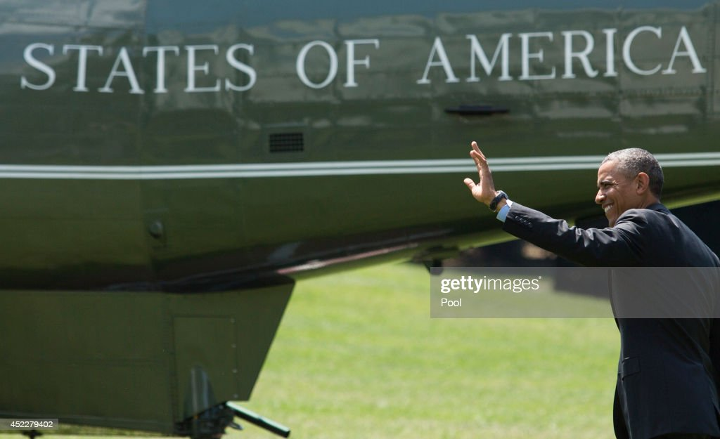 U.S. President Barack Obama waves to onlookers as he walks toward Marine One, on the South Lawn of the White House on July 17, 2014 in Washington, DC. President Obama is traveling to Wilmington, Delaware to make an infrastructure announcement and then on to New York City, where he will participate in DNC fundraising.