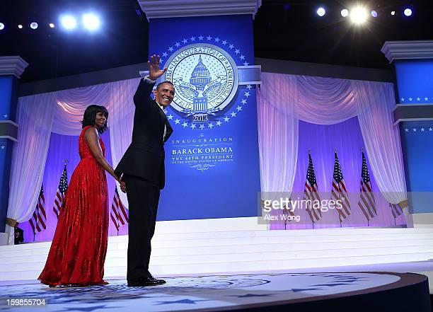 S President Barack Obama waves to supporters after dancing with first lady Michelle Obama during the CommanderinChief's Inaugural Ball January 21...