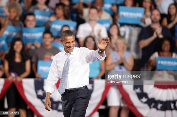 S President Barack Obama waves to supporters as he arrives to his campaign rally at Desert Pines High School on September 30 2012 in Las Vegas Nevada...