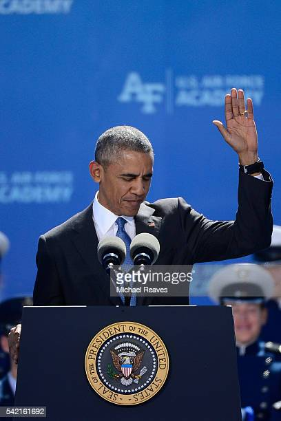 President Barack Obama waves to the crowd as he addresses the United States Air Force Academy 58th graduating class on June 2 2016 at Falcon Stadium