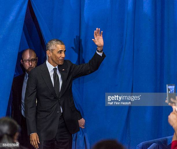 President Barack Obama waves to the crowd at Gwendolyn Brooks College Prep on the South Side of Chicago Illinois In addition to speaking the...