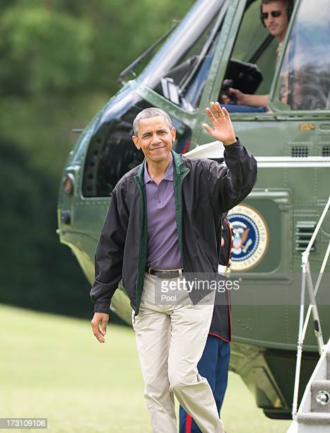 US President Barack Obama waves to the media as he arrives on the South Lawn of the White House July 7 2013 in Washington DC Obama spent the holiday...