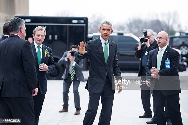 President Barack Obama waves to the media as Rep Peter King RNY Speaker of the House John Boehner ROhio and Irish Prime Minister Enda Kenny look on...