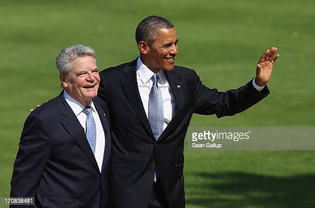 President Barack Obama waves to the media while walking with German President Joachim Gauck at Bellevue Palace on June 19, 2013 in Berlin, Germany....