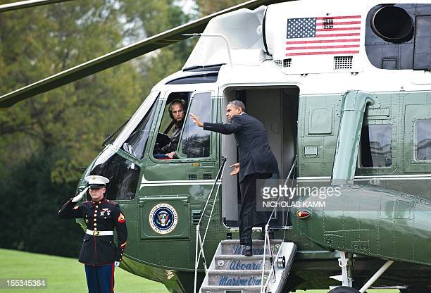 President Barack Obama waves to visitors as he departs the White House in Washington on November 3, 2012 for a campaign trip that will take him to...