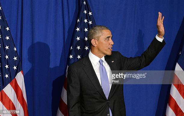 President Barack Obama waves while speaking at the Consumer Financial Protection Bureau on October 17, 2014 in Washington, DC. In his speech, he...