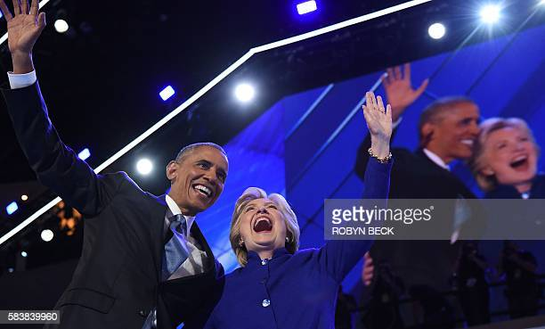 President Barack Obama waves with US Presidential nominee Hillary Clinton during the third night of the Democratic National Convention at the Wells...