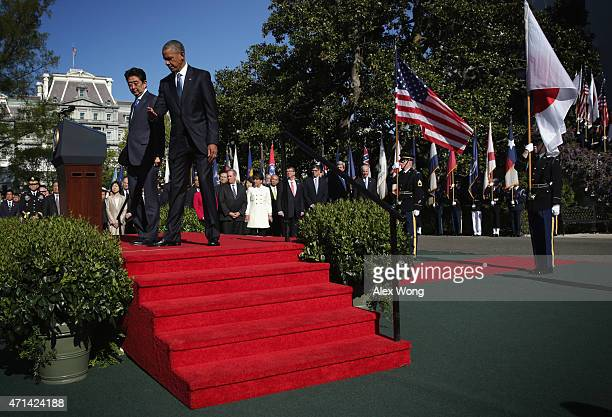 US President Barack Obama welcomes Japanese Prime Minister Shinzo Abe during an official arrival ceremony at the South Lawn of the White House April...