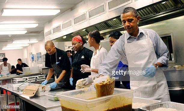 US President Barack Obama with daughter Malia Obama and from left Jeffrey Ragsdale Jamillah Linkins and Marianne Ali participate in a service project...