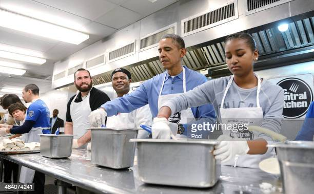 US President Barack Obama with daughter Sasha participate in a community service project at the DC Central Kitchen in celebration of the Martin...