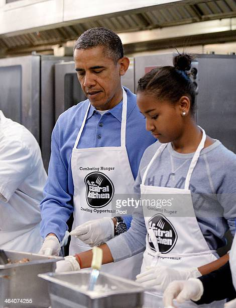 President Barack Obama with daughter Sasha participate in a community service project at the D.C Central Kitchen in celebration of the Martin Luther...