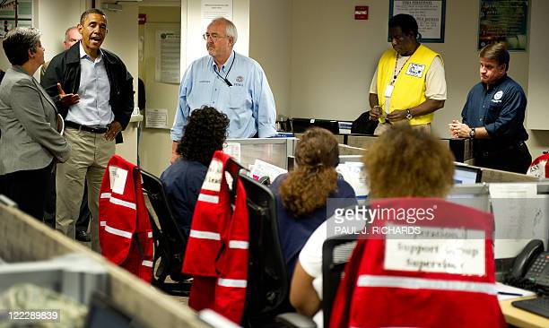 President Barack Obama , with Federal Emergency Management Agency Administrator Craig Fugate and Homeland Security Janet Napolitano visits with...