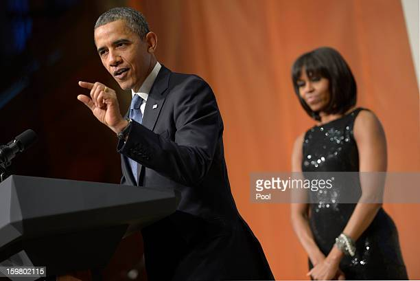 US President Barack Obama with First Lady Michelle Obama delivers remarks at the Inaugural Reception at the National Building Museum on January 20...